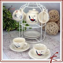 Juego de té de cerámica con diseño de pájaro y stander de hierro