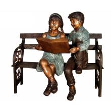 Garçon et fille métal artisanat enfants bronze lecture statue pour jardin