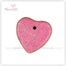 Piedra pómez en forma de corazón rojo para el cuidado de los pies