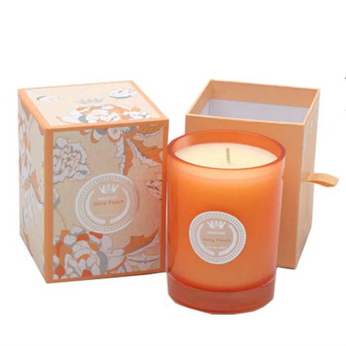 scented gift candle in orange glass cup