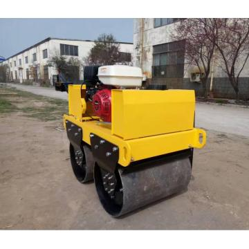 Hand operated diesel engine starting road roller