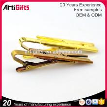 El fabricante hace su propio clip de lazo de encargo al por mayor de encargo del metal del oro del metal del logotipo