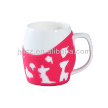 Taza de café blanca llana de cerámica 600cc con la manga del silicón