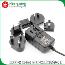 18V1.5A AC/ DC Power Adaptor with Exchangeable Us Au UK EU Jp Cn Plugs