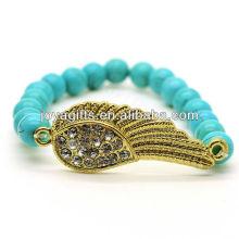 Fashion Turquoise 8MM Runde Perlen Stretch Edelstein Armband mit Diamante Wing in der Mitte