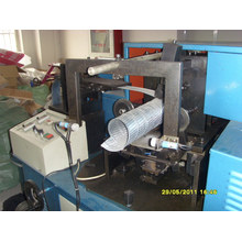 Machine de fabrication de noyau de filtre en spirale