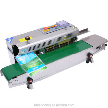 sealing machinery Automatic  Continuous Plastic Bag Band Sealing bag sealer and also can print date use ink roller