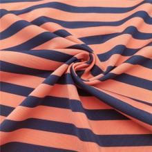 Tela spandex rayas naranjas y negras para trajes de baño