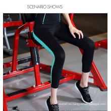Pantalones apretados de la yoga de la aptitud de Spandex del culturismo de encargo al por mayor atractivo para las mujeres