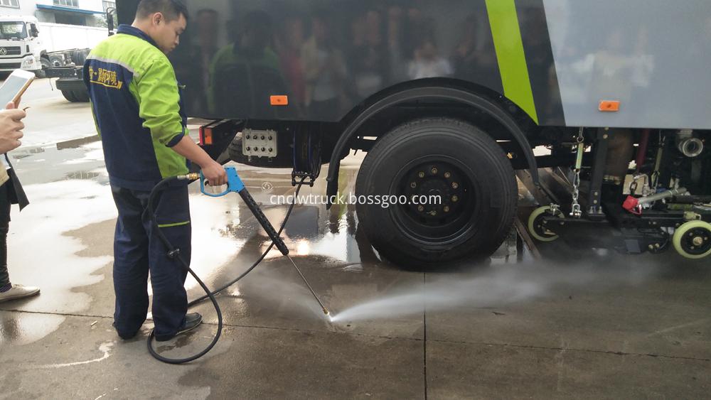 street sweeping truck high pressure washing