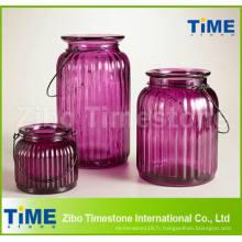 Bougeoir en verre de couleur violette
