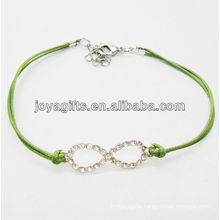 Green wire diamante number eight alloy woven bracelet