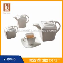 Juego de té y café de cerámica con el sistema de la olla del té, la olla de azúcar y el tarro de la leche