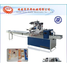 Electrical accessory flow wrapping machine