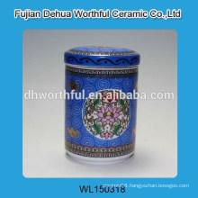 Elegant ceramic blue sugar canister with flower figurine