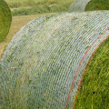 Open mesh bale wrap netting for straw