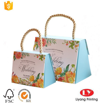 Elegant paper gift box with gold handle