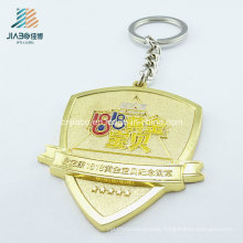 Hot Selling Products Alloy Casting Gold Embossed Custom Badge Keychain