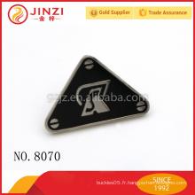 Étiquettes de logo en métal personnalisées à main