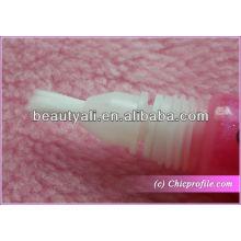 Tubo cosmético con la cabeza del cepillo