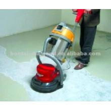 Различный бетонный пол с пылесосом