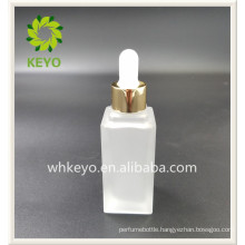 20ml Hot sale high quality square colored empty cosmetic packing glass dropper bottle