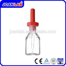 JOAN Cristalería de laboratorio que cae la botella con el látex goma Pezón
