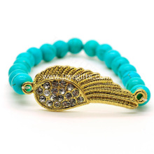 Turquoise 8MM Round Beads Stretch Gemstone Bracelet with Diamante Wing Piece