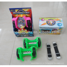 Niños que se divierten que destellan las ruedas que destellan