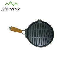 frigideira redonda do ferro fundido do óleo vegetal com punho de madeira