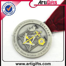 Antique silver medal with red ribbon