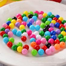 Perlas de plástico sueltas redondas negras de 10 mm