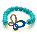 Turquoise 8MM Round Beads Stretch Gemstone Bracelet with Diamante alloy butterflyPiece