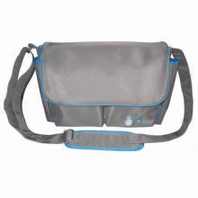 Diaper bag for baby, made of microfiber, brand name design with many compartment pockets
