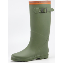 Green Rubber Boots With Buckle Beside