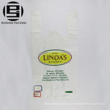 Maneje las bolsas de compras plásticas polivinílicas de la camiseta