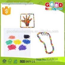 Venta caliente calificados niños juguetes de juego OEM madera gabe juguetes 8 colores juguetes educativos puntos