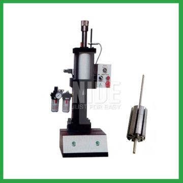 Radiator cooling fan motor armature shaft inserting machine