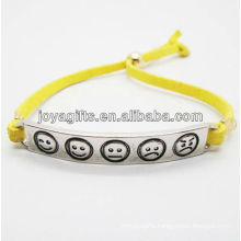 2013 fashion yelolw leather bracelet with silver alloy carved phiz symbol