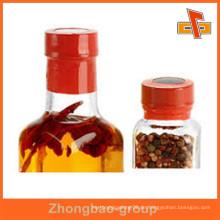 Heißer Verkauf kundengerechte bunte Hitze empfindliche Wasserbeweis druckbare schrumpfbare Flaschenkappen rote Aufkleber mit Druck