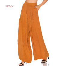 Pantalones de moda de apertura de pierna grande mostaza elástica