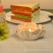 Suportes de vela cerâmicos artesanais de lótus