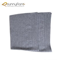 Knitted cashmere baby blanket with cable pattern
