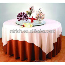 Delicate decorative polyester overlay for table