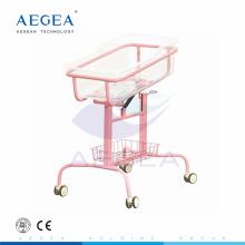 AG-CB009 Rosa Farbe Stahl Unterstützung mit ABS Korb Baby Krankenhausbett