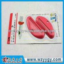 Dispositivo de espremedor popular de dentes de plástico personalizado para promoção