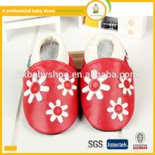 Los zapatos de bebé de cuero verdaderos superventas de la zalea genuina del patrón animal de la alta calidad