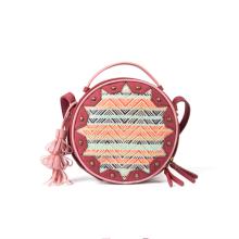 Tenunan warna-warni dan tas bulat vintage