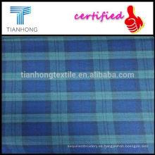 Peso pesado Peached tela de franela de cuadros para camisas de manga larga camisas Casual camisas tela hilado teñido lana azul controles