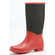 Red Rubber Rain Boots With Black Lace On It